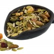 Pile and scoop of healthy trail mix — Stock Photo