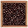 Dried cranberries in wooden box - Stock Photo