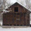Stock Photo: Old, small barn iduring snow storm
