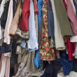 Messy closet overfilled with clothes — Foto Stock