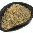 Scoop of long grain brown rice — Stock Photo