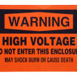High voltage orange warning sign — Stock Photo