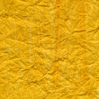 Crumpled yellow painted paper texture — Stock Photo