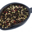 Stock Photo: Scoop of colorful rainbow peppercorns