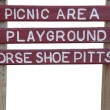 Picnic area and playground sign — Stock Photo #2057564
