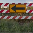 Stock Photo: End of road barrier with arrow sign