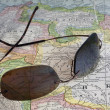 Sun glasses over  South America map — Stock Photo