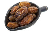 Scoop of dried medjool dates — Stock Photo