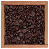 Dried cranberries in wooden box — Stock Photo