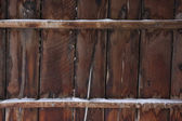 Weathered wood of old barn in winter — Stock Photo