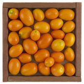 Kumquats in a rustic, wooden box — Stock Photo