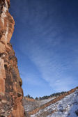 Red sandstone cliff and blue sky — Stock Photo