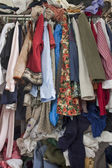 Messy closet overfilled with clothes — Stock Photo