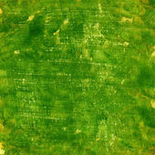 Green grunge painted paper texture — Stock Photo
