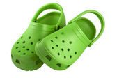 Bright green plastic clogs — Stock Photo