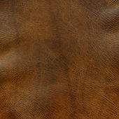 Krisdrabbade brunt läder textur — Stockfoto
