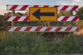 End of road barrier with arrow sign — Stock Photo