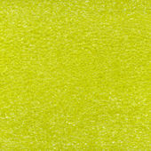 Yellow plastic foam texture — Stock Photo