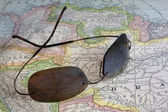 Sun glasses over South America map — Stok fotoğraf