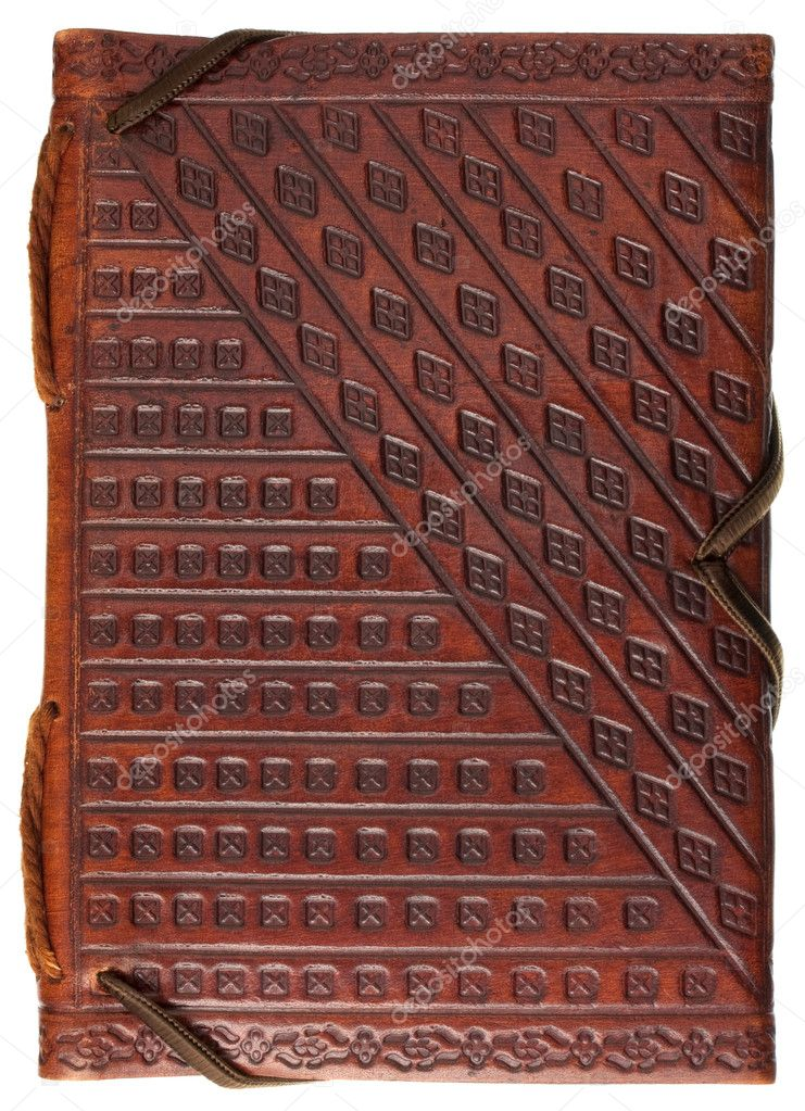 Diary or scrapbook in a red stamped leather with geometrical pattern  ornaments isolated on white — Stock Photo #2050459
