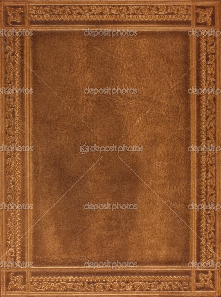 Brown leather book or journal cover with a decorative floral ornament — Stock Photo #2050773