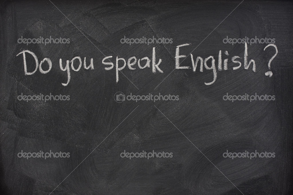 Do you speak English question handwritten with white chalk on a blackboard with eraser smudges — Stock Photo #2052738