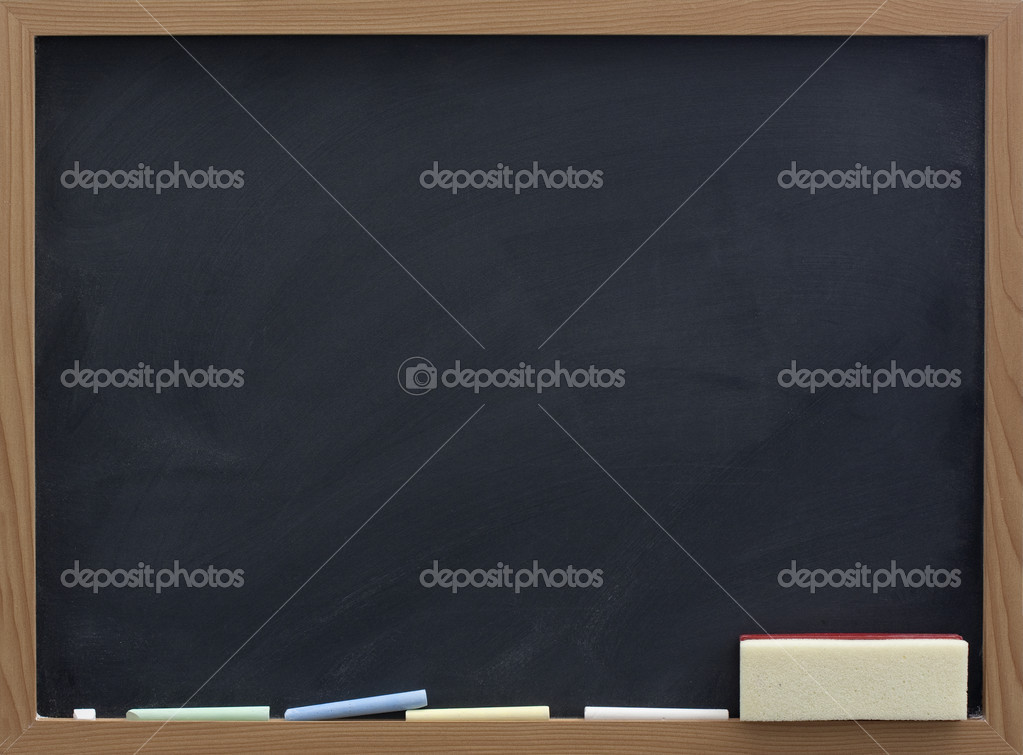 Blank blackboard with eraser and chalk, smudge patterns,  white dust  Foto Stock #2053467