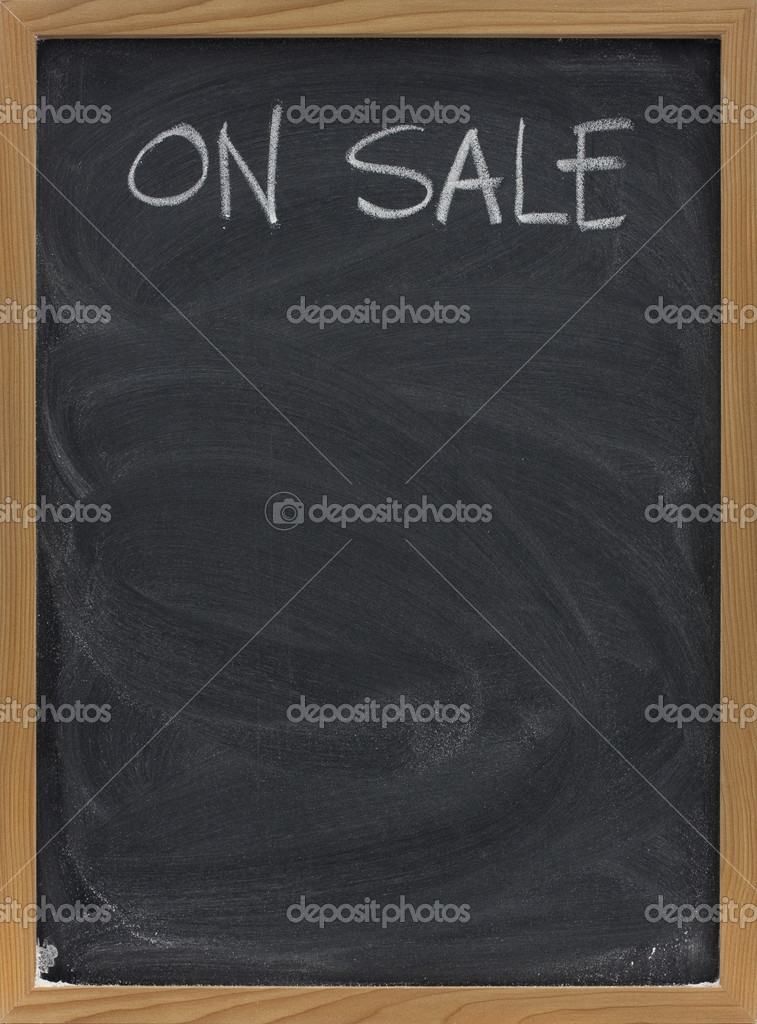 Discount sale advertisement handwritten with white chalk on blackboard, copy space below — Stockfoto #2054674