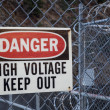 Danger, high voltage, keep out sign - Stock Photo