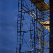 Construction scaffolding, nighttime - Stock Photo