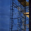 Stock Photo: Construction scaffolding, nighttime