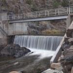 Diversion dam on a mountain river — Stock Photo