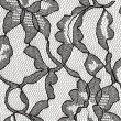 Black lace fabric with flower pattern - Stock Photo