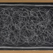 White chalk scribble on blackboard — Stock Photo