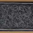 Stock Photo: White chalk scribble on blackboard