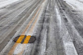 Slippery icy road with yellow line — Stockfoto
