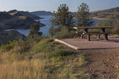 Table on shore of mountain reservoir — Stock Photo