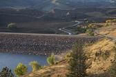 Rock dam on mountain reservoir — Stock Photo