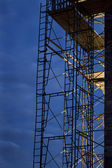 Construction scaffolding, nighttime — Stock Photo