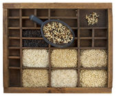 Rice grains in vintage wooden drawer — Stock Photo