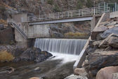 Diversion dam on a mountain river — Stock Photo