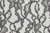 Black lace fabric with flower pattern — Stock Photo