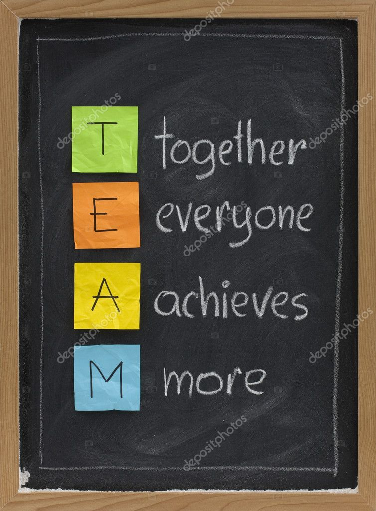 TEAM acronym (together everyone achieves more), teamwork motivation concept, color sticky notes, white chalk handwriting on blackboard — Stock Photo #2061962