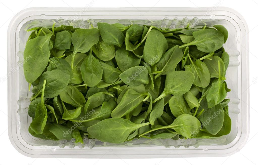 Fresh green baby spinach in a clear plastic grocery box isolated on white with clipping path — Stock Photo #2062089