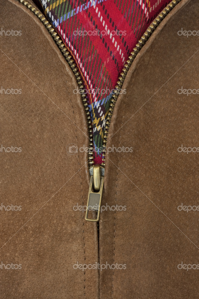 Close-up of unzipped brass zipper of chamois leather jacket showing a red scarf — Zdjęcie stockowe #2062108