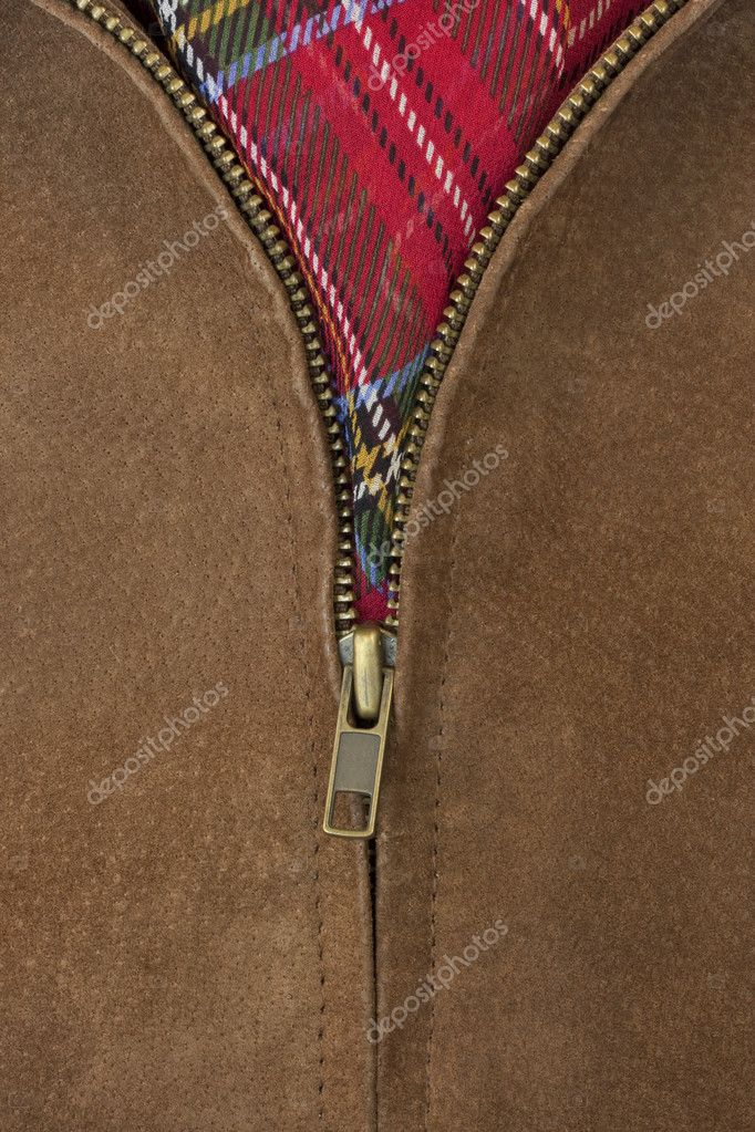 Close-up of unzipped brass zipper of chamois leather jacket showing a red scarf  Stock Photo #2062108