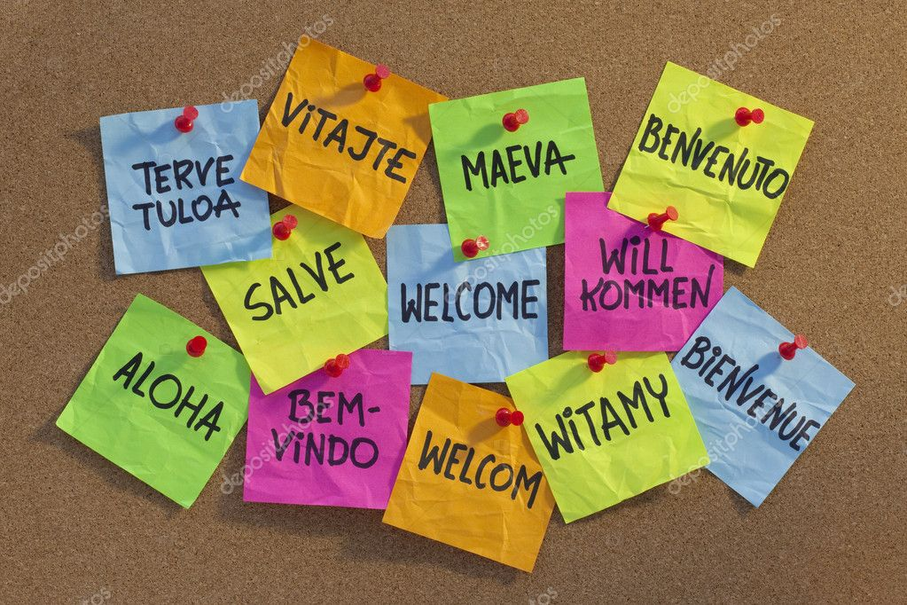 Welcome in a dozen of languages (Finnish, Slovak, Tahitian, Italian, Latin, English, German, Hawaian, Portuguese, Dutch, Polish, French) - cloud of colorful sti — Stock Photo #2062299