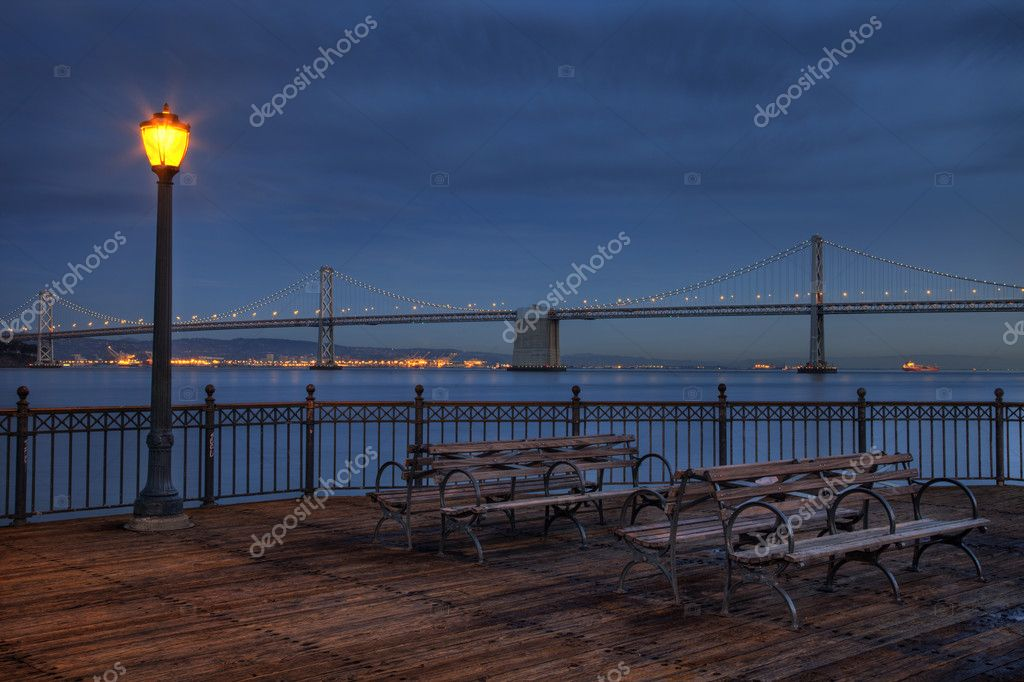 San Francisco at night - Bay Bridge and harbor from Pier 7 — Stockfoto #2062444