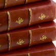 Stack of old books in red leather — Stock Photo #2433031