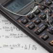Stock Photo: Scientific calculator, reading glasses